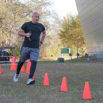 Participant running serpentine through cones