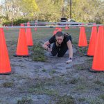 Participant crawling under cones