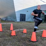 Participant stepping over hurdles